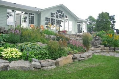 Natural stone for lush garden and pond
