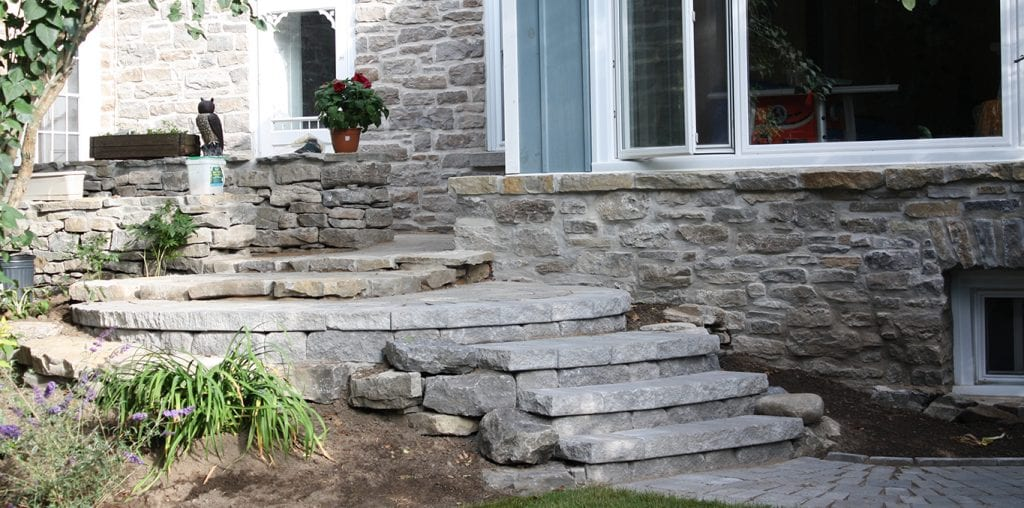 Custom-made stone steps leading to front door of a house